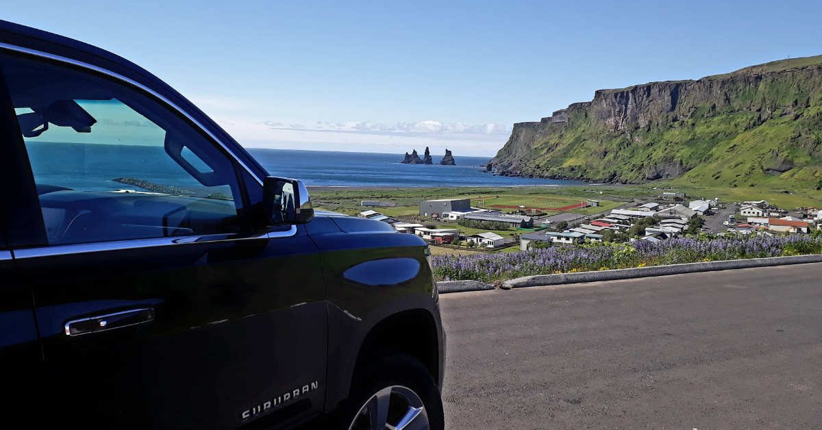 Black Suburban in Vík í Mýrdal view of Reynisdrangar